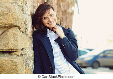 outdoor portrait of a stylish woman in a street.