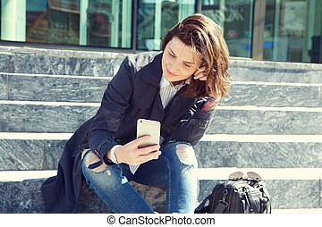 outdoor portrait of a stylish woman with smartphone.