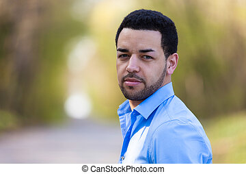 Outdoor portrait of a young latin american man