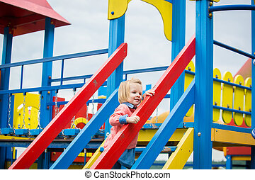 Outdoor portrait of adorable little girl playing in park