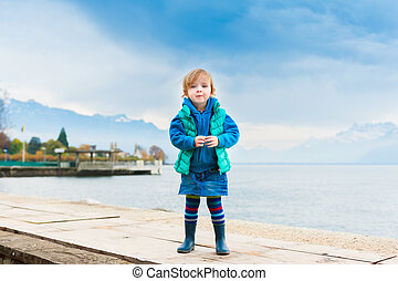 Outdoor portrait of adorable toddler girl
