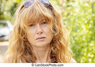 outdoor portrait of adult woman
