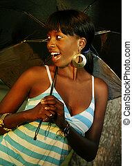 Outdoor Portrait Of African American Girl Holding Umbrella