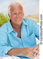 Outdoor Portrait of An Attractive Handsome Senior Man