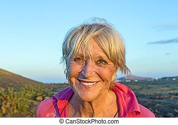 outdoor portrait of attractive elderly woman