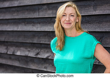 Outdoor Portrait of Attractive Middle Aged Woman