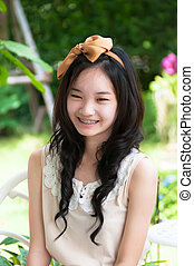 young asian chinese woman smiling