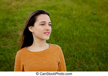Outdoor portrait of beautiful happy teenager girl