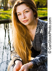 Outdoor portrait of beautiful serene young woman