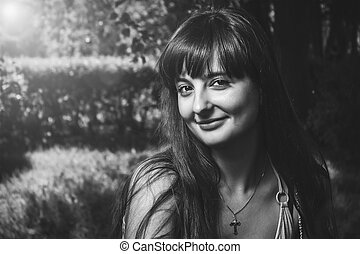 outdoor portrait of beautiful smiling girl with the sun and lens