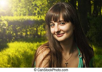 outdoor portrait of beautiful smiling girl