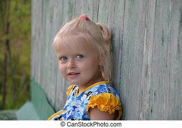 outdoor portrait of cute Caucasian blond girl