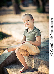 Outdoor portrait of cute little boy