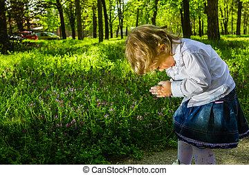 Outdoor portrait of cute little girl on the meadow - Blond...