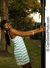 Outdoor Portrait Of Girl Swing In Pole