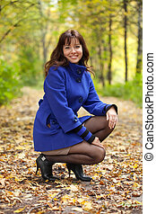 happy woman in autumn