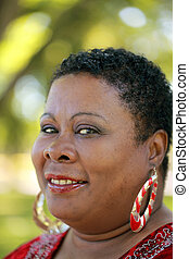 Outdoor portrait of heavy black middle-aged woman