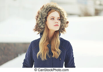 Outdoor portrait of hipster stylish girl in the city