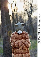 Outdoor portrait of man wearing sad cat costume