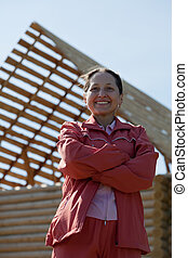 mature woman against building home