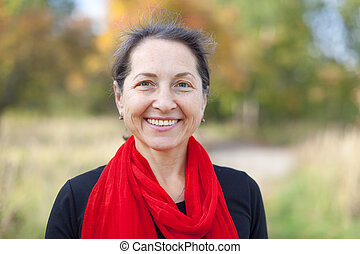 Outdoor portrait of mature woman in autumn