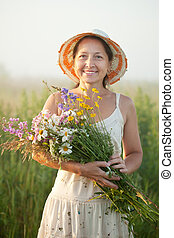 mature woman with flowers posy