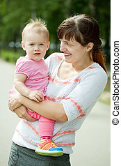 mother with adorable toddler - Outdoor portrait of mother ...