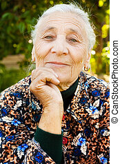 Outdoor portrait of one elegant senior woman