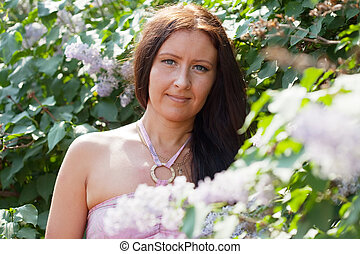 woman in lilac plant