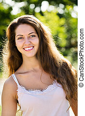 Outdoor portrait of smiling woman