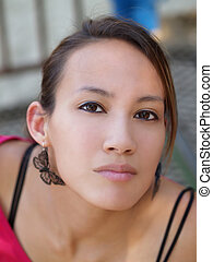Outdoor portrait of young asian american woman