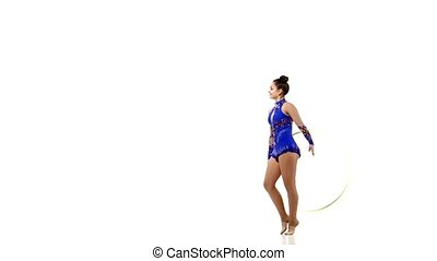 Outdoor portrait of young beautiful  woman gymnast  with hula hoop
