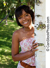 Outdoor portrait of young black woman