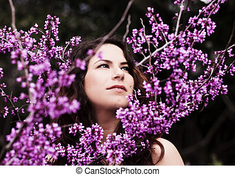 Outdoor Portrait Of Young Caucasian Woman Amid Spring Blossoms