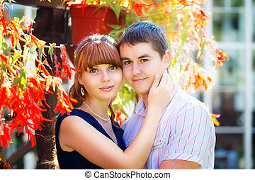 Outdoor portrait of young sensual couple. Love and kiss. Summer