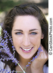 Outdoor portrait smiling attractive young caucasian woman