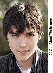 Outdoor portrait teen caucasian boy dark hair - Young Teen...