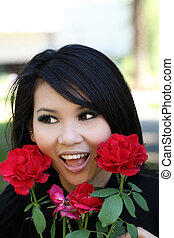 Outdoor portrait young asian american woman rose