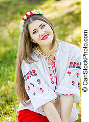 Outdoor portrait young woman with l