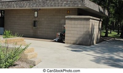 Outdoor public restroom - A disabled man in a wheelchair...