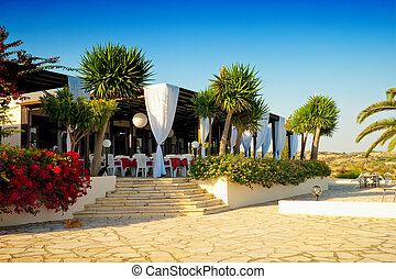 Outdoor restaurant at the beach . Cyprus