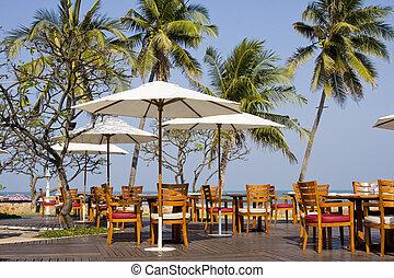 Outdoor restaurant at the beach . Thailand .
