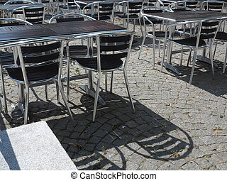 Outdoor restaurant cafe chairs with table