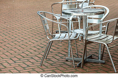 Outdoor restaurant coffee open air cafe chairs with table.