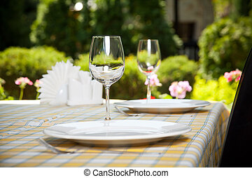 Outdoor restaurant dining table, place setting