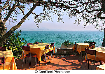 Outdoor restaurant in Sirmione, Italy. - An outdoor ...
