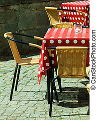 Outdoor restaurant open air cafe chairs with table