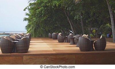 Outdoor Restaurant Seating at Luxury Resort in Maldives -...