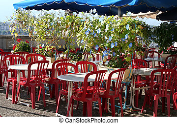 Outdoor restaurant - Outdoor restaurant with chairs and...