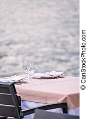 Outdoor restaurant table by the sea